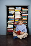 Little boy reading on the floor Royalty Free Stock Photography