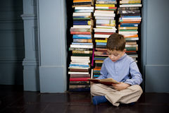 little boy reading on the floor Stock Photography