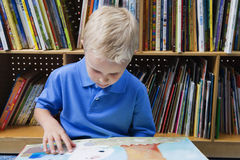Little Boy Reading A Picture Book Royalty Free Stock Photos