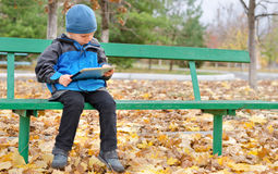 Little boy reading a tablet computer Royalty Free Stock Photography