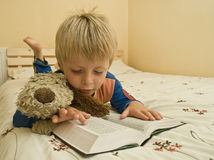 Little boy reads the bible. Stock Photo