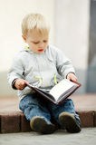 Little boy reads book Royalty Free Stock Image