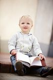 Little boy reads a book Royalty Free Stock Image