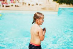 Little boy ready to dive into swimming pool stock images