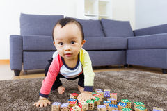 Little boy ready to jump. On the carpet Royalty Free Stock Photos