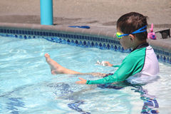 Little boy ready to swim in pool. Wearing goggles, summer day Stock Photos