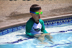 Little boy ready to swim in pool. Wearing goggles, summer day Royalty Free Stock Image