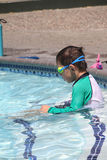 Little boy ready to swim in pool. Wearing goggles, summer day Stock Photography
