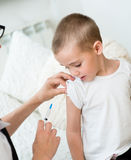 Little boy receiving injection or vaccine Royalty Free Stock Photography