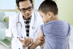 Little boy receiving vaccine injection royalty free stock photos