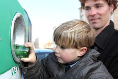 Little boy by recycling bin Stock Images