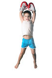 Little boy with red boxing gloves victory jump on white background isolated Stock Photography