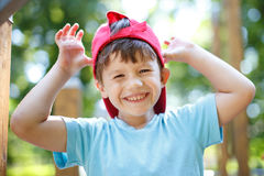 Little boy in red cap mocking Royalty Free Stock Image