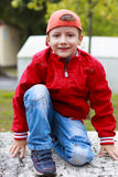 Little boy in red cap smiling Stock Photo