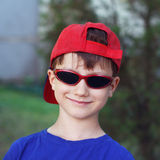 Little boy in red cap and sunglasses Stock Image