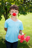 Little boy with red clown nose Royalty Free Stock Photography