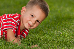 Little boy in red on the green grass Stock Photo
