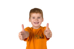 The little boy with red hair shows gesture Stock Photography