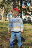 Little Boy with Red Hat Stock Image