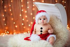 Little boy in a red hat Stock Photo