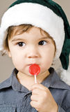 Little Boy with a Red Lollipop Royalty Free Stock Photos