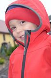 Little boy in red rain jacket Stock Photo