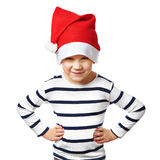 Little boy in red Santa hat is funny and angry isolated Royalty Free Stock Photography