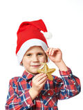 Little boy in red Santa hat with golden star Royalty Free Stock Image