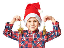 Little boy in red Santa hat with golden stars Royalty Free Stock Photo