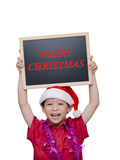 Little boy in red Santa hat holding chalkboard Royalty Free Stock Photography