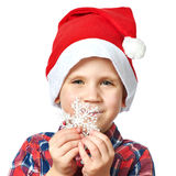 Little boy in red Santa hat with snowflake Stock Photo