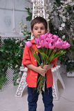 Little boy in a red shirt and a bouquet of tulips Stock Photography