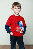 Little boy in a red shirt, hands in the pockets Stock Image