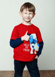 Little boy in a red shirt, hands in the pockets Royalty Free Stock Photo