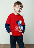 Little boy in a red shirt, hands in the pockets Stock Photo