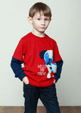 Little boy in a red shirt is staying in business pose, hands in Royalty Free Stock Photography