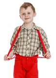 Little boy in red shorts with straps, close-up Stock Image