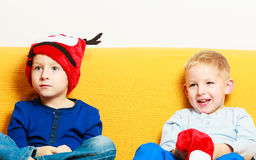 Little boy in red winter reindeer hat with his brother Stock Image