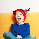 Little boy in red winter reindeer hat at home Royalty Free Stock Photos