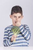 Little boy refusing to eat his vegetables Royalty Free Stock Image