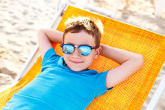 Little boy relax on deckchair Royalty Free Stock Photos
