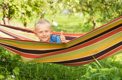 Little boy relax in hammock into the garden Stock Photo