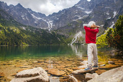 Little boy relax on mountain lake coast Stock Photo
