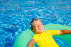 Little boy relax in pool Royalty Free Stock Photography