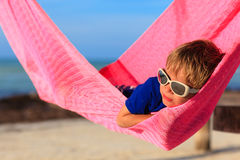 Little boy relaxed in hammock on the beach Royalty Free Stock Photos