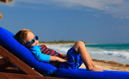 Little boy relaxed on summer beach Stock Image