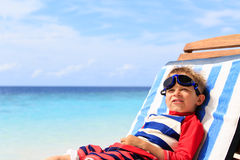 Little boy relaxed on summer tropical beach Royalty Free Stock Photography
