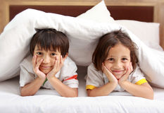 Little boy relaxing. Two little boy smiling relaxing in the bedroom Stock Images