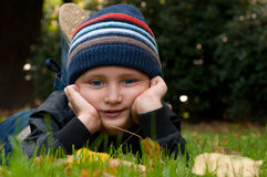 Little boy relaxing in the park Royalty Free Stock Photo