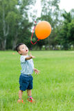 Little boy release balloon. Little boy release his balloon stock images